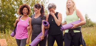 women carrying yoga mats