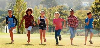 children running in a yard
