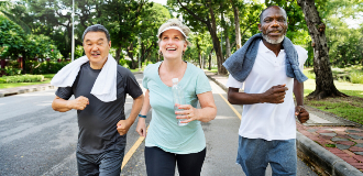 diverse seniors exercising in park for health